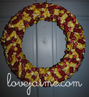 Red and yellow ribbon wreath