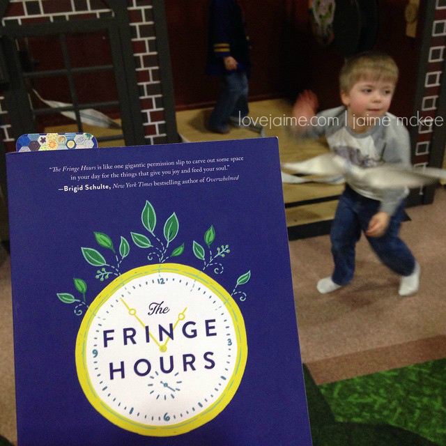 I read The Fringe Hours at a play area where my son was having a blast.