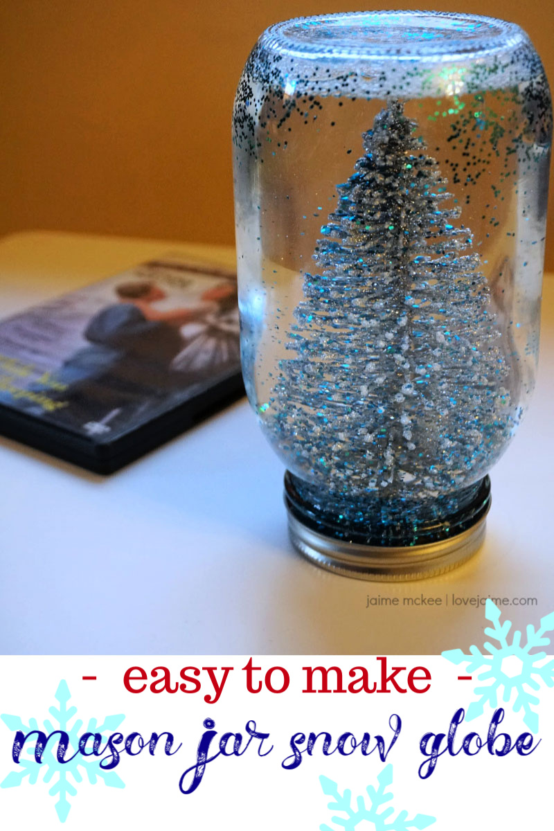 This DIY snow globe is SO simple to make and really pretty! Finally put glitter to good use (and not get it everywhere when the jar is sealed.) This is part of the #ChristmasMoviesHop
